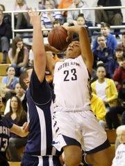 Elmira Notre Dame's Derrick Stark drives to the basket