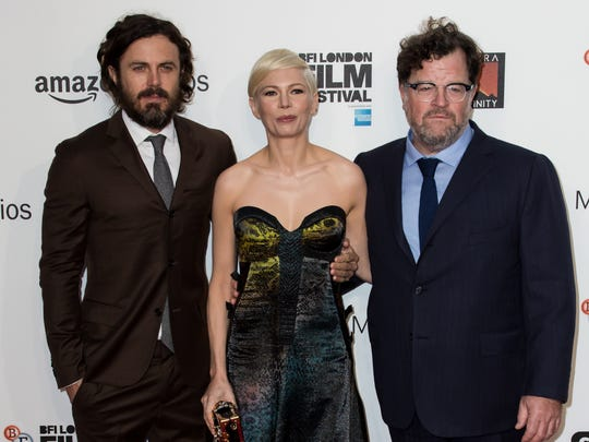 From Left, Actors Casey Affleck, Michelle Williams and director Kenneth Lonergan pose for photographers on arrival at the premiere of the film 'Manchester By The Sea', showing as part of the London Film Festival in London, Saturday, Oct. 8, 2016.