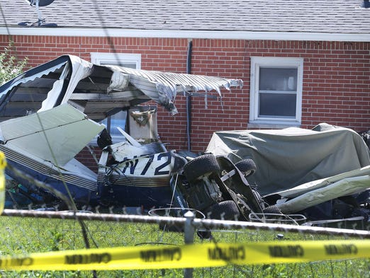 One person died when an airplane crashed into the backyard of a home on Patterson Street in Greenwood Friday July 11, 2014. This is the scene following the crash.