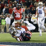 LSU Tigers wide receiver Malachi Dupre (15) is stopped short of the goal line by Ole Miss Rebels defensive back Trae Elston (7) during the fourth quarter of Saturday's game. Dupre says the Tigers need to eliminate mistakes.