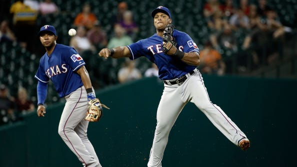 HOUSTON, TX - AUGUST 28:  Elvis Andrus #1 of the Texas Rangers makes a throw to first base during the fifth inning of a game against the Houston Astros being held at Minute Maid Park on August 28, 2014 in Houston, Texas.  (Photo by Stacy Revere/Getty Images)