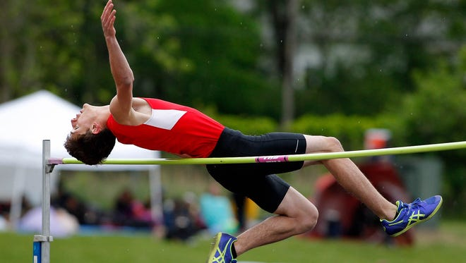 St. Johns' Travis Feldpausch competes in the high jump during the MHSAA Division 2 track regionals Friday, May 19, 2017, in Williamston, Mich.