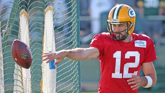 Green Bay Packers quarterback Aaron Rodgers (12) works on his pitch during camp July 29, 2017, at Ray Nitschke Field.