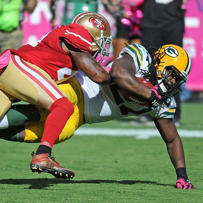 Green Bay Packers running back Eddie Lacy dives for