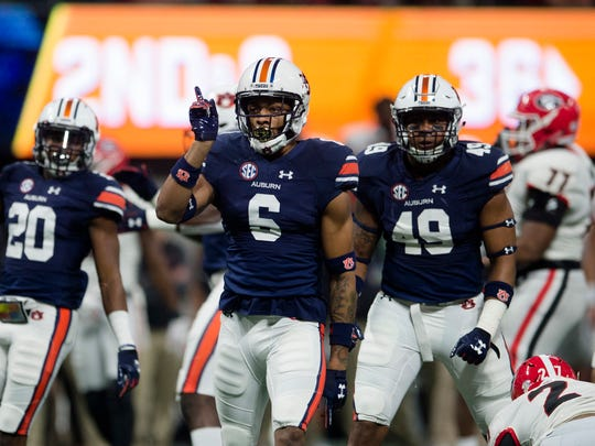 Carlton Davis (6) left Auburn after his junior year and was taken in the second round of the 2018 NFL draft.