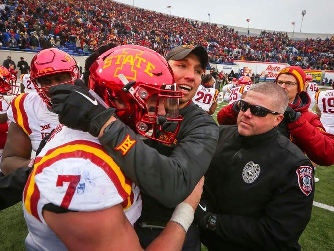 ISU head coach Matt Campbell hugs linebacker Joel Lanning