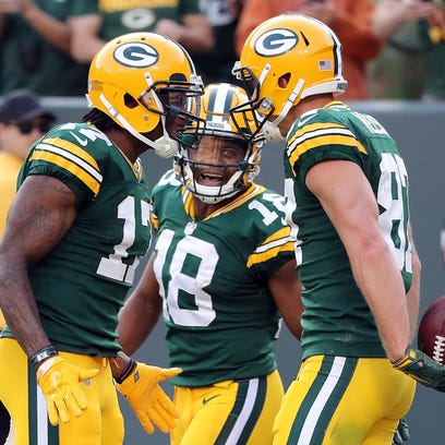 Packers wide receiver Jordy Nelson (right) is congratulated