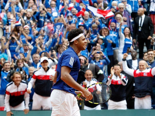 Wilfried Tsonga of France jubilates after winning the Davis Cup semi final against Serbia at the Pierre Mauroy stadium in Lille, northern France, Sunday, Sept.17, 2017. (AP Photo/Michel Spingler)