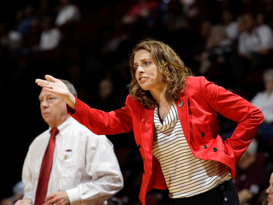 FILE - In this Saturday, March 17, 2012 file photo, Arkansas assistant coach Nicki Collen gestures during the first half of an NCAA tournament first-round college basketball game in College Station, Texas. Nicki Collen has been named head coach of the Atlanta Dream, it has been announced by owners Mary Brock and Kelly Loeffler, Monday, Oct. 30, 2017. (AP Photo/David J. Phillip, File)