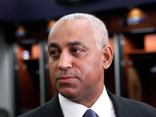 FILE - In this Oct. 4, 2010, file photo, Omar Minaya speaks to the media in the New York Mets clubhouse at Citi Field in New York. Minaya is returning to the Mets as a special assistant to Sandy Alderson, who replaced him as general manager after the 2010 season. (AP Photo/Seth Wenig, File)