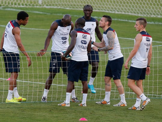Players of the French national soccer team, from left, Loic Remy, Eliaquim Mangala, Rio Mavuba, Bakary Sagna, Mathieu Debuchy and Lucas Digne play tennis-ball during a training session at the Santa Cruz stadium in Ribeirao Preto, Brazil, Sunday, June 22, 2014. Having captured people's attention at the soccer World Cup with some scintillating attacking football, France's players are now in unknown territory after raising expectations back home, having routed Switzerland and Honduras. (AP Photo/David Vincent)