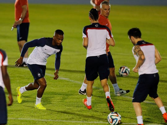 France's Patrice Evra, second left, run on the field during an official training session at the Joao Havelange Olympic stadium, in Rio de Janeiro, Brazil, Tuesday, June 24, 2014. France will play its next game against Ecuador in group E of the 2014 soccer World Cup. A draw is enough to guarantee top spot for France, and would also send Ecuador through to the next round if Switzerland fails to beat Honduras in the other match. (AP Photo/David Vincent)
