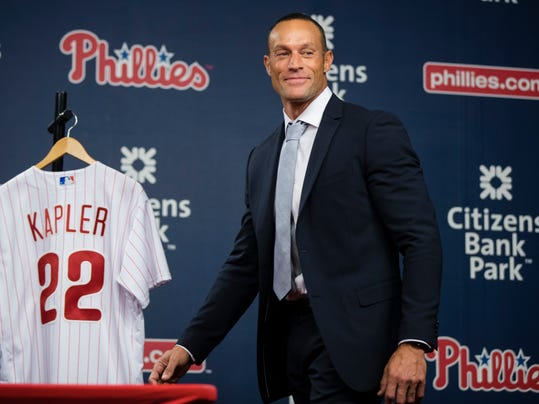 Philadelphia Phillies new manager Gabe Kapler walks onto the stage for a news conference in Philadelphia, Thursday, Nov. 2, 2017. Kapler  replaces Pete Mackanin, who moved into a front-office position. (AP Photo/Matt Rourke)