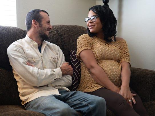 Matt and Sarah Becquet share a moment during and interview