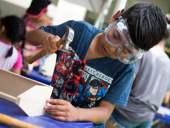 Bryan Balverde, 9, builds a tool box at the Secret City Festival in Oak Ridge on Saturday, June 10, 2017. The festival celebrates the arts, culture and history of Oak Ridge.