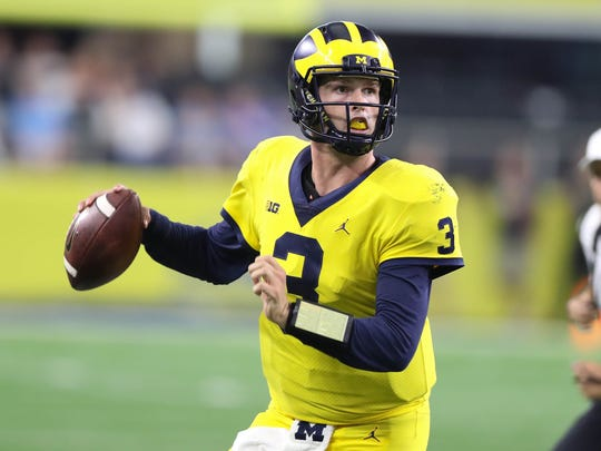 Michigan's Wilton Speight looks to pass in the fourth
