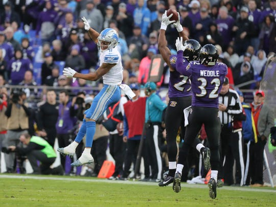 Lions wide receiver Marvin Jones Jr. can only watch as the Ravens' Marlon Humphrey to intercepts a Matthew Stafford pass during the fourth quarter of the Lions' 44-20 loss on Sunday, Dec. 3, 2017, in Baltimore.