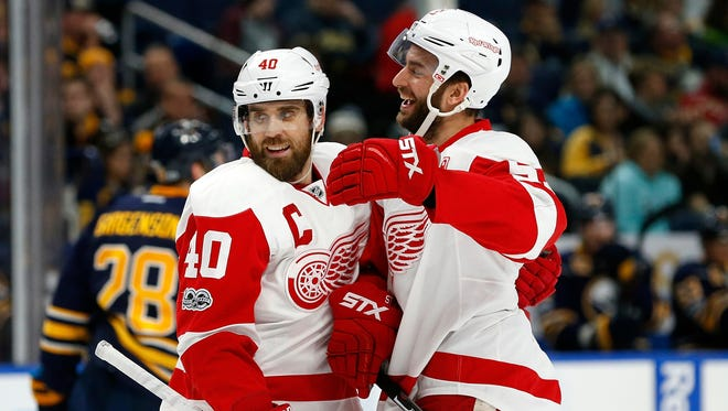 Red Wings center Frans Nielsen (51) celebrates his goal with left wing Henrik Zetterberg (40) during the first period Friday in Buffalo, N.Y.