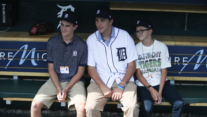 Tigers first-round draft pick Alex Faedo, center, on July 5, 2017 at Comerica Park.