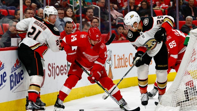 Gustav Nyquist battles for the puck with Ducks center Chris Wagner (21) and right wing Ondrej Kase in the first period Tuesday.