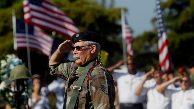 In this news-press.com file photo, Barry Gellert salutes during the playing of the National Anthem at the Fort Myers Memorial Gardens Annual Memorial Day Remembrance in 2010.