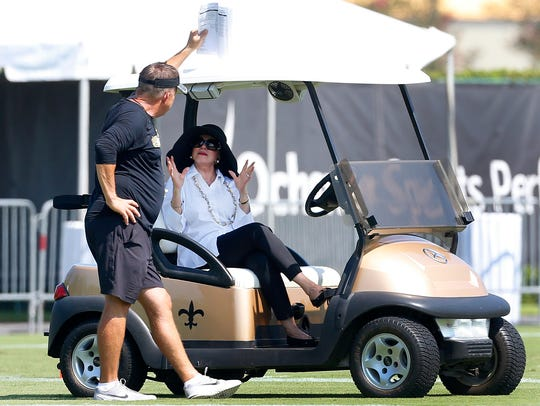 New Orleans Saints owner Gayle Benson talks to head