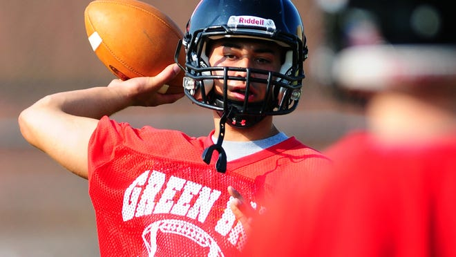 Green Bay East High School quarterback Chris Frelich throws during Wednesday's practice.