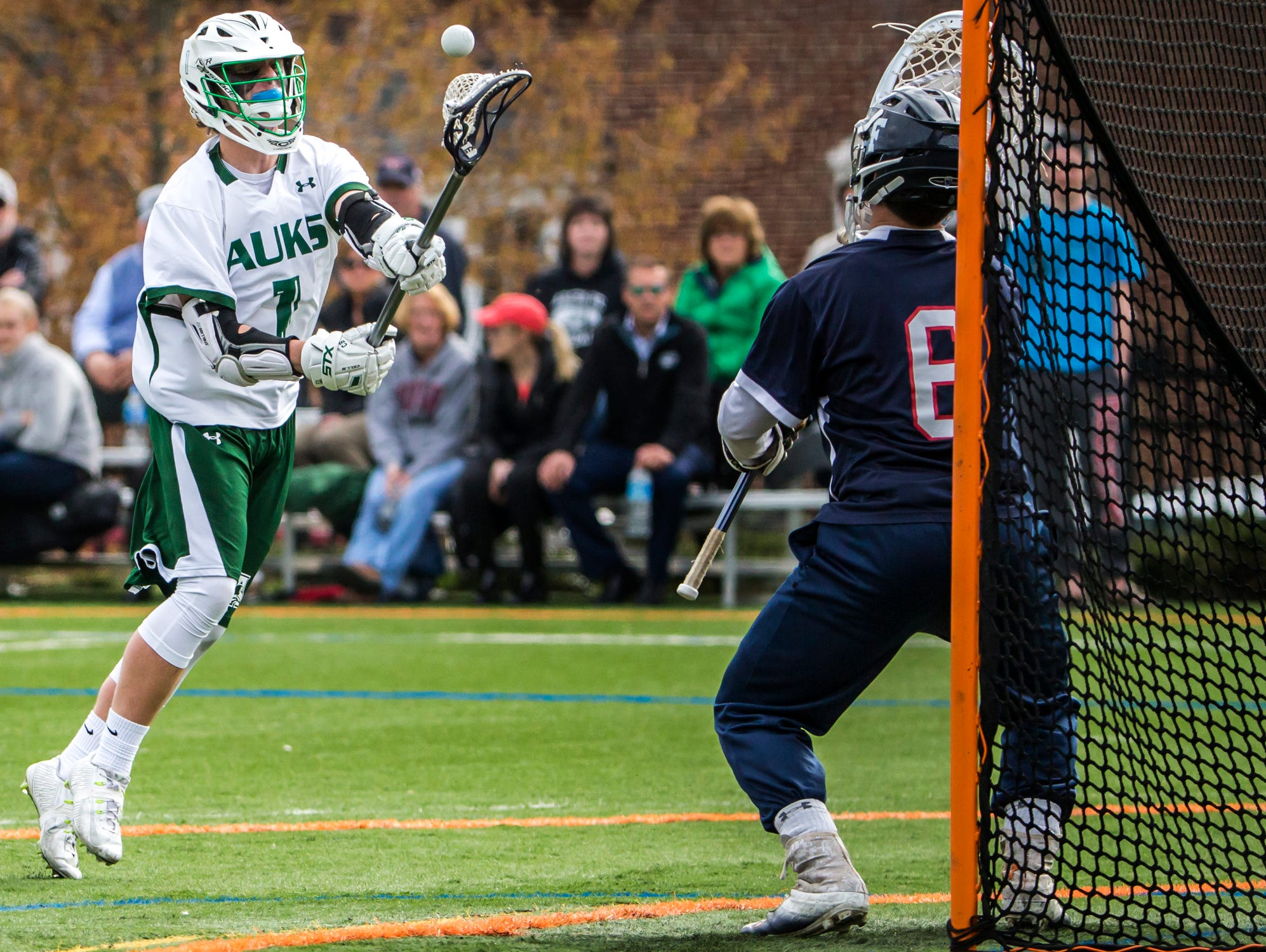 Archmere's Cole Bauer puts a shot on Friends' Jakob Katzen in Archmere Academy's 13-8 win over Wilmington Friends School at Archmere on Thursday afternoon.