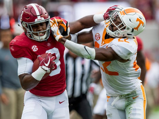 Alabama running back Josh Jacobs (8) is forced out