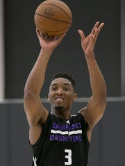 Donovan Mitchell takes a shot at the end of a workout