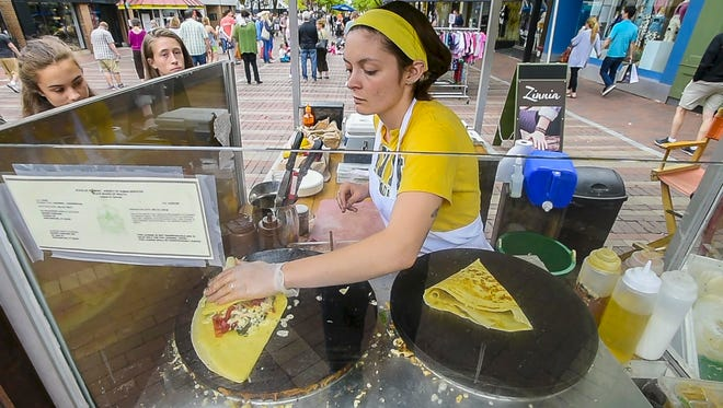 Daisy Hoagland cooks up a pair of crepes at The Skinny Pancake food cart on Church Street in Burlington on Sunday, June 4, 2017.