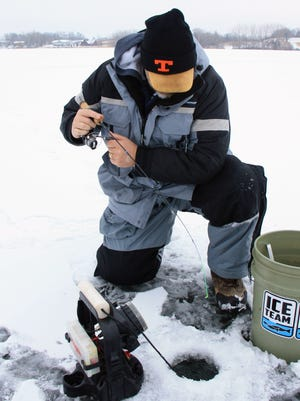 Local angler Steve Taylor fights a crappie on the first ice trip of the year.