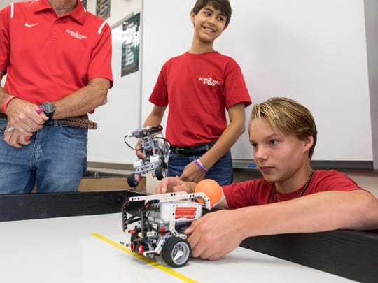 Joseph Manna sets up his robot to test in Robert Ludlow's robotics class at Incarnate Word Academy Middle School on Wednesday, Sept. 27, 2017.