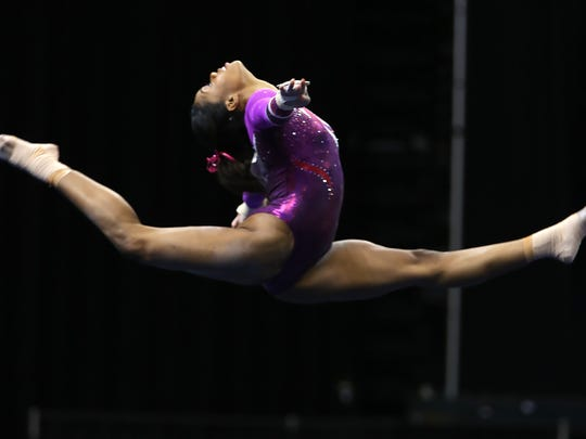 Gabby Douglas flies over in her floor event during the P&G Championships Senior Women's rounds at Bankers Life Fieldhouse, Saturday, August 15, 2015.