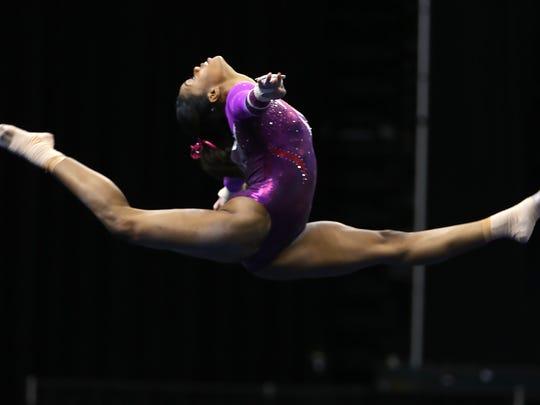 Gabby Douglas flies over in her floor event during