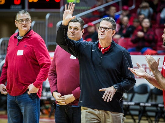 Former Ball State basketball player and Yorktown High School coach Greg Miller joins other former players for a ceremony during half time of Ball State's game against Western Michigan Saturday, Jan. 28, 2017.