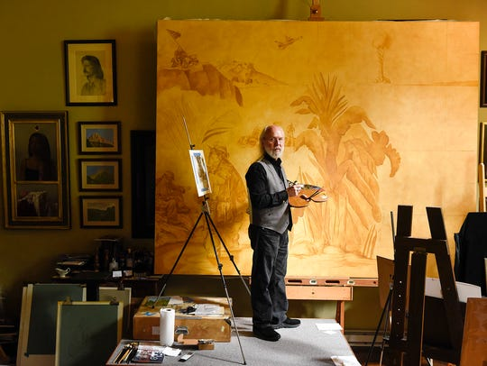Artist Charles Kapsner works on the underpainting and