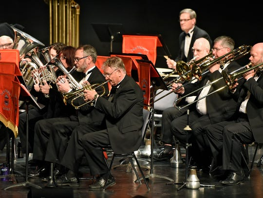 The Lake Wobegon Brass Band members concentrate during