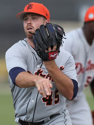 Detroit Tigers pitcher Buck Farmer goes through drills during Tigers spring training on Wednesday, Feb. 15, 2017 at Publix Field at Joker Marchant Stadium in Lakeland, Fla.