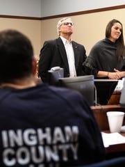 Larry Nassar listens as Kassie Powell addresses Ingham Circuit Judge Rosemarie Aquilina on Jan. 19, 2018.