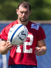 Andrew Luck practices during organized team activities