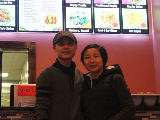 Amy Yang, right, and Huang Gao, left, are the owners