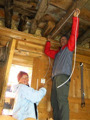 Farmington residents Caroline Creyke and David Griffin wire LED lights for the 2014 Minya Konka monastery projects.