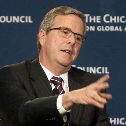 Former Florida Gov. Jeb. Bush answers questions after