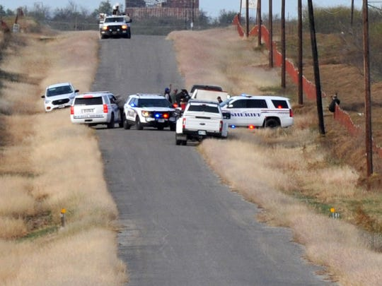 Several emergency agencies work the scene of a helicopter crash Monday afternoon on a rural road near Electra, Texas. Reports came in that a helicopter seen in the area struck some nearby utility lines and crashed in a field not far from the roadway. The crash is under investigation.