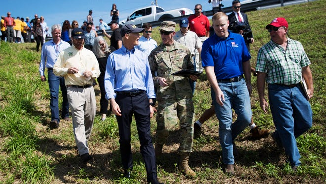 Florida Governor Rick Scott visited Clewiston to meet with officials Monday 10/9/2017 about the health of the Herbert J. Hoover Dike that surrounds Lake Okeechobee. He is talking with Col. Jason Kirk, the Commander and District Engineer from the US Army Corps of Engineers out the Jacksonville District at the Clewiston City Boat Ramp.