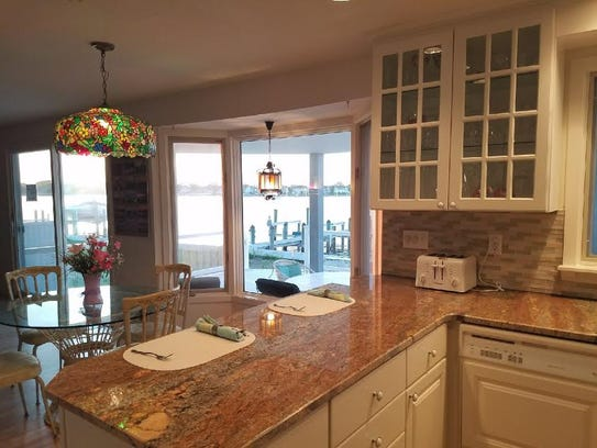 The kitchen has a granite stone breakfast nook.
