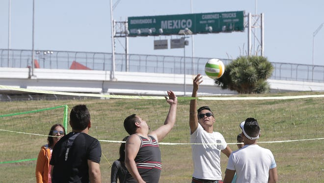 Family and friends play a game of volleyball as they enjoy their Easter outing at the Chamizal National Memorial. The park, bordered on its east end by the Bridge of the Americas, is a popular destination for family outing as well as Music Under the Stars.