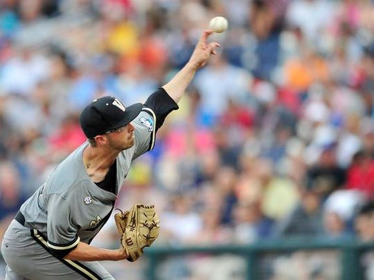 Vanderbilt pitcher Philip Pfeifer throws a pitch against Virginia during the first inning in the Game 2 of the College World Series finals at TD Ameritrade Park, Tuesday, June 23, 2015, in Omaha, Neb.