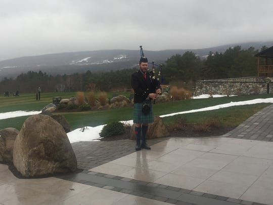 A bagpiper bid Bill Young farewell at Bristol Mountain Lodge.